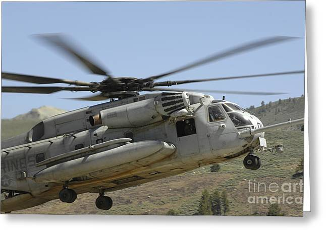Landing Gear Greeting Cards - A Ch-53 Super Stallion Helicopter Lands Greeting Card by Stocktrek Images