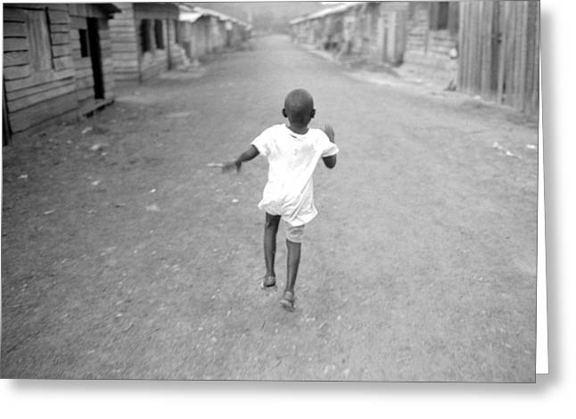 African Child Greeting Cards - A Child Runs Down A Dirt Road Greeting Card by Michael Nichols