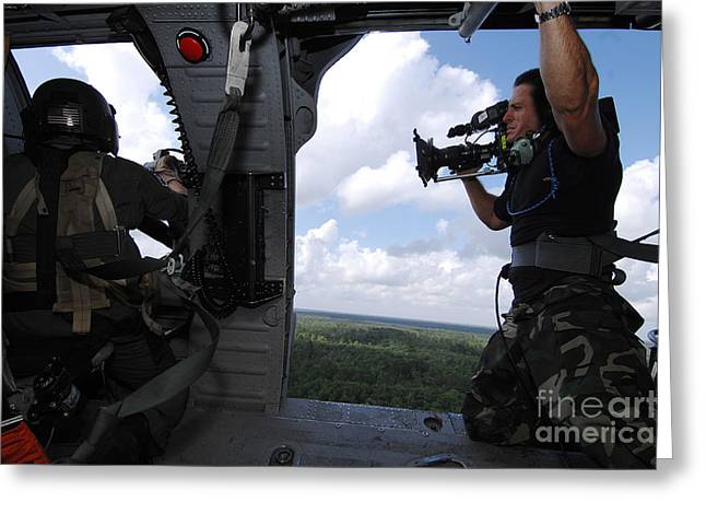 Helicopter Photographs Greeting Cards - A Cinematographer Videotapes A Soldier Greeting Card by Stocktrek Images