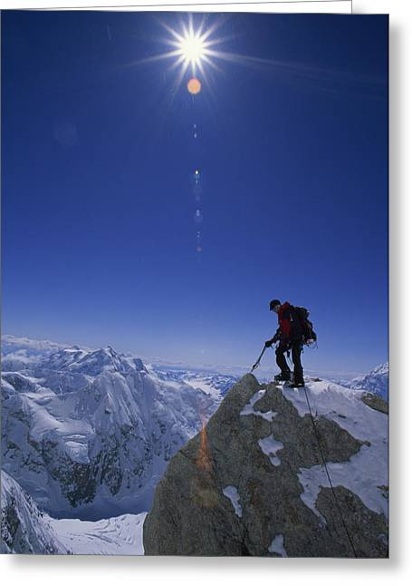 Knapsack Greeting Cards - A Climber With An Ice Axe Above Snow Greeting Card by Bill Hatcher