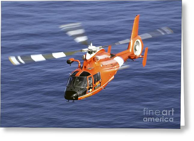Law Enforcement Greeting Cards - A Coast Guard Hh-65a Dolphin Rescue Greeting Card by Stocktrek Images