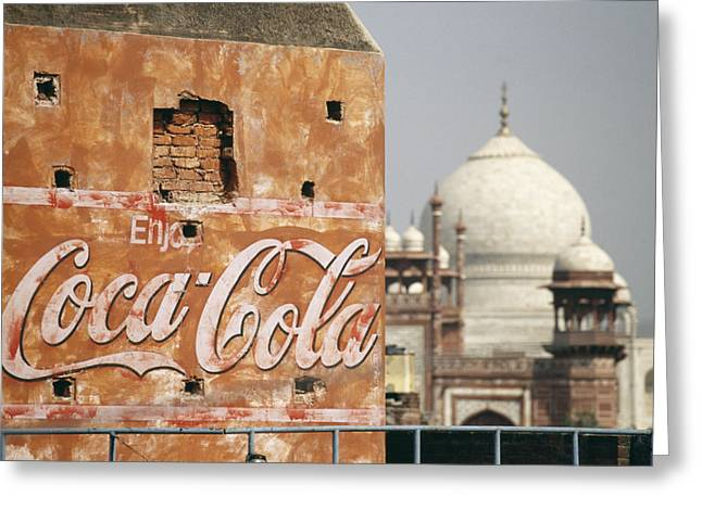 Globalization Greeting Cards - A Coca Cola Billboard On A Building Greeting Card by Justin Guariglia
