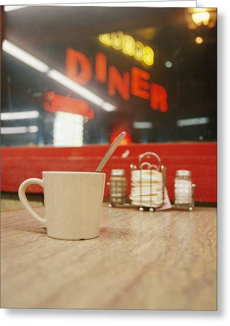 Night Cafe Greeting Cards - A Coffee Cup And A Diner Sign Spell Greeting Card by Stephen St. John