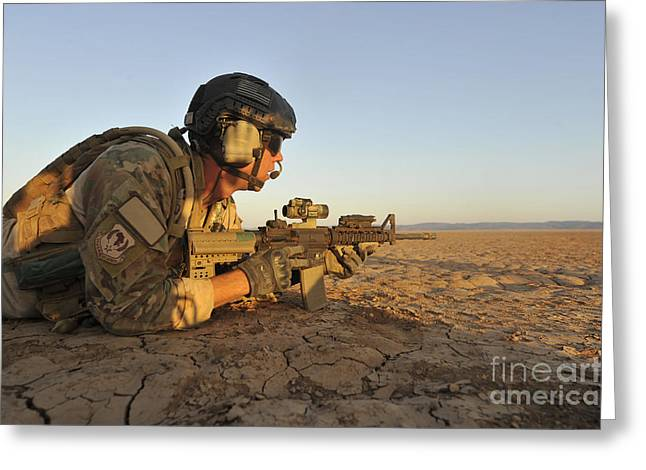 A Combat Rescue Officer Provides Greeting Card by Stocktrek Images