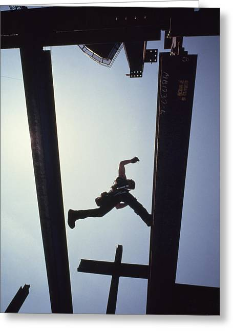 Urban And Suburban Ways Of Life Greeting Cards - A Construction Worker Jumps From Girder Greeting Card by Lynn Johnson