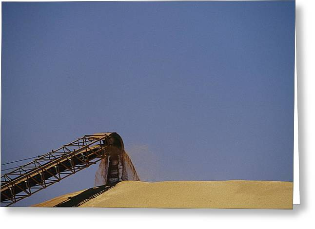 Conveyor Belt Greeting Cards - A Conveyor Belt Loads Wheat Grain Onto Greeting Card by Jason Edwards