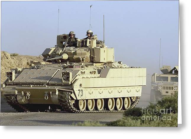 Hmmwv Greeting Cards - A Convoy Of Bradley And Humvee Armored Greeting Card by Stocktrek Images