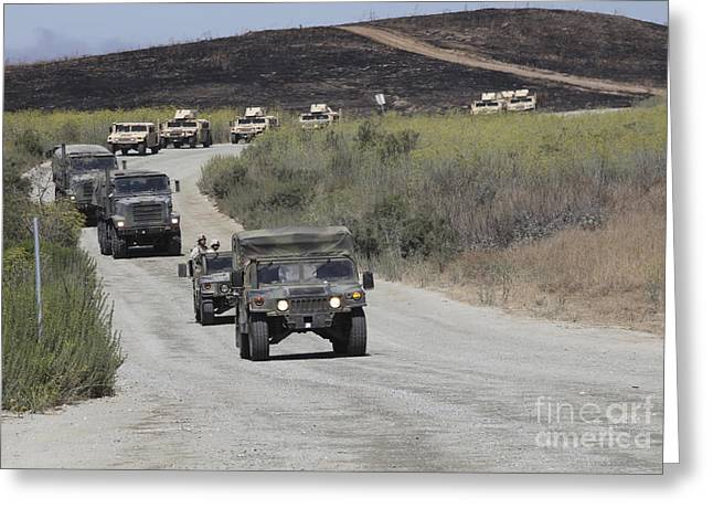 Hmmwv Greeting Cards - A Convoy Of Military Vehicles Greeting Card by Stocktrek Images