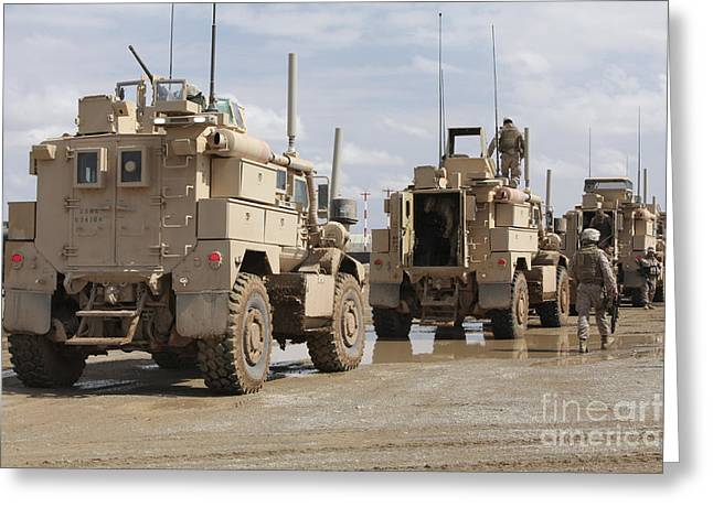 Convoy Greeting Cards - A Convoy Of Mrap Vehicles Near Camp Greeting Card by Stocktrek Images