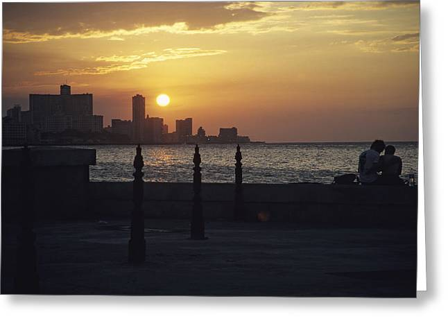 Malecon Greeting Cards - A Couple Embrace On Havanas Malecon Greeting Card by David Evans