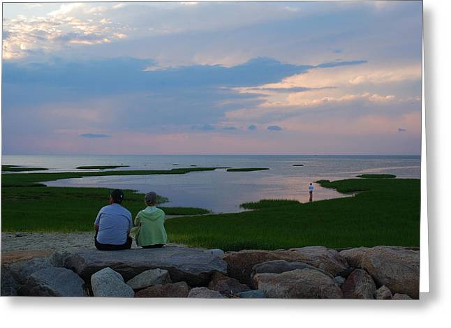Mid Adult Women Greeting Cards - A Couple Sit On A Rock Watching Sunset Greeting Card by Darlyne A. Murawski