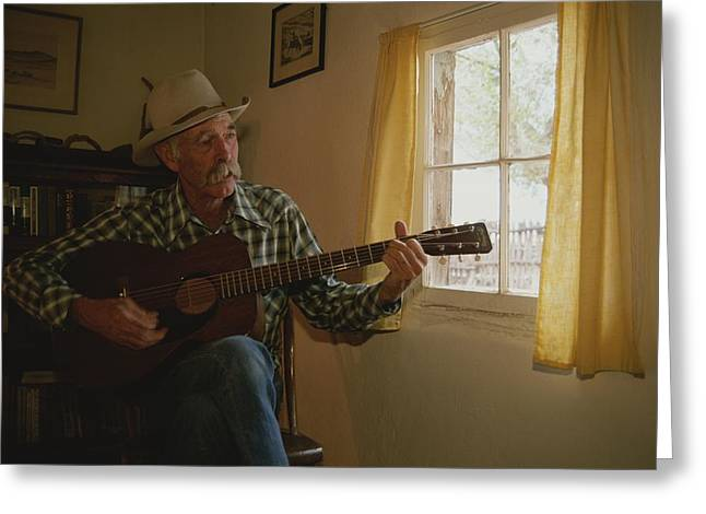 Window Of Life Greeting Cards - A Cowboy Entertains With His Guitar Greeting Card by Stacy Gold