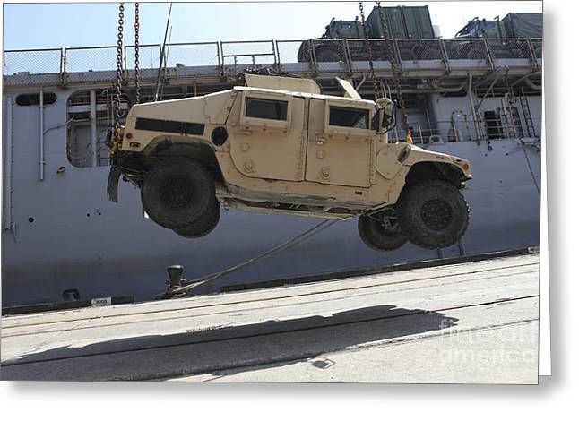 Uss North Carolina Greeting Cards - A Crane Lifts An M998 Humvee Greeting Card by Stocktrek Images