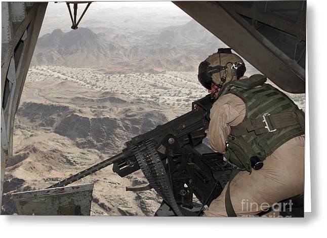 .50 Caliber Greeting Cards - A Crew Chief Aims The Gau-21 .50 Greeting Card by Stocktrek Images