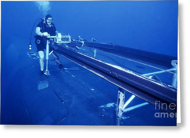 A Crewman Cranks Out The Dry Deck Greeting Card by Michael Wood