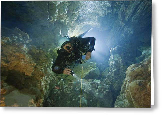 A Diver Ascends A Deep Shaft In Dans Greeting Card by Wes C. Skiles