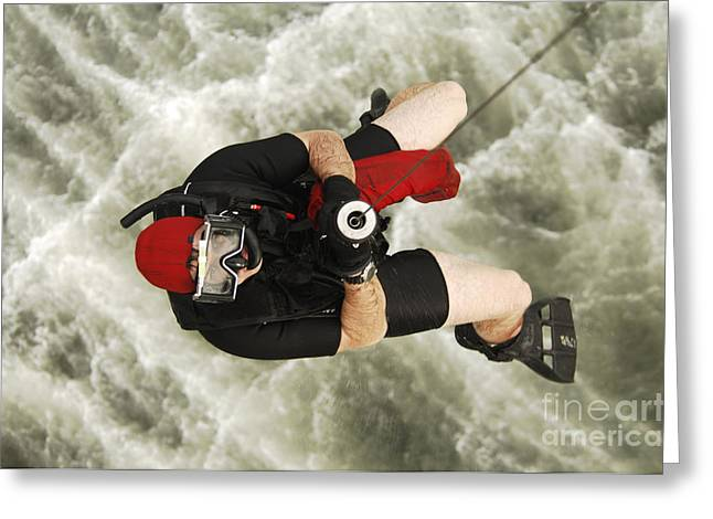 Swimsuit Photography Greeting Cards - A Diver Is Hoisted Aboard An Sh-60f Greeting Card by Stocktrek Images
