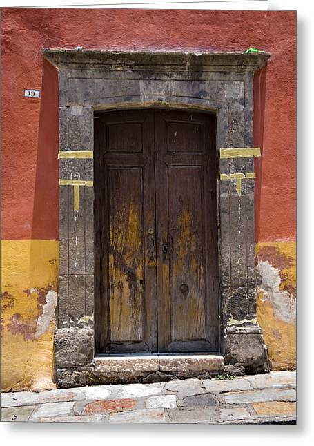 A Door In A Painted Building Greeting Card by David Evans