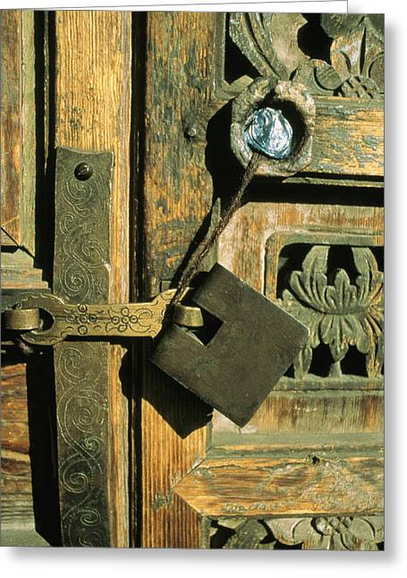 Doors And Doorways Greeting Cards - A Doorway With An Ornately Carved Latch Greeting Card by Ed George
