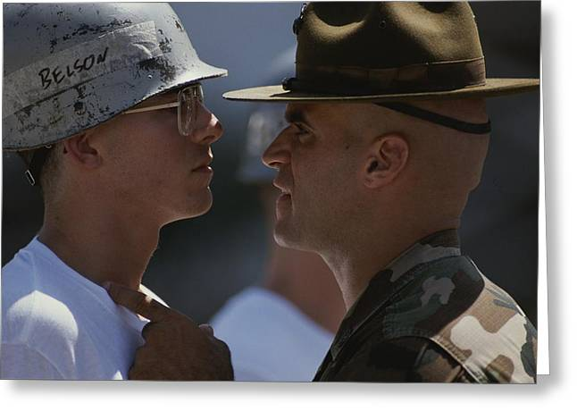 Take Action Greeting Cards - A Drill Sergeant Taunts A New Recruit Greeting Card by Joel Sartore