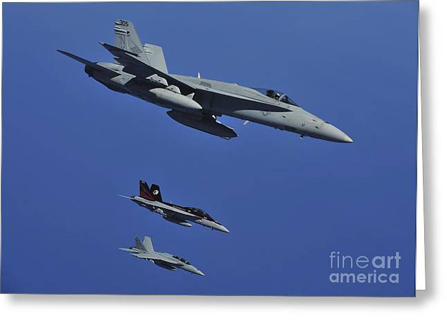 F-18 Greeting Cards - A Fa-18c Hornet Flies Near Two Fa-18f Greeting Card by Stocktrek Images