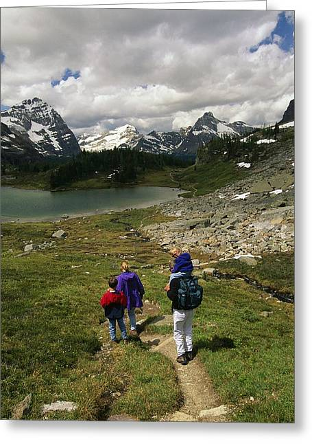 Mountain Road Greeting Cards - A Family Hikes Toward A Lake In Yoho Greeting Card by Michael Melford