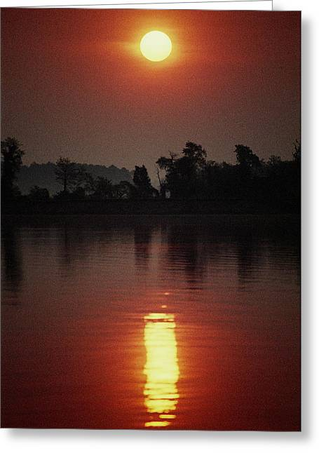 River View Greeting Cards - A Fiery Sun Rises Above The Tree-lined Greeting Card by Stephen St. John