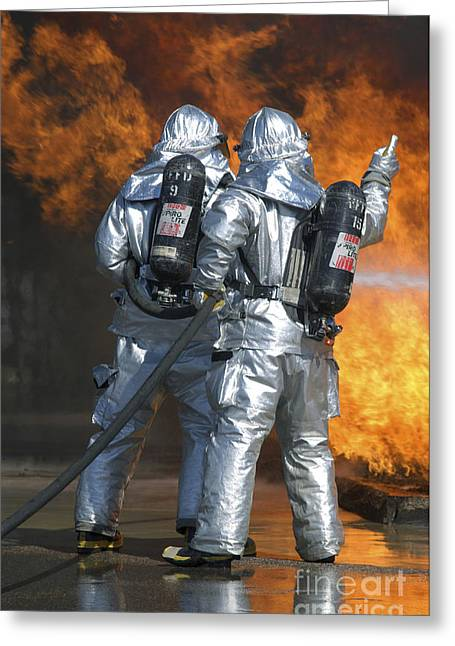 Oxygen Tank Greeting Cards - A Firefighter Fights A Fire Greeting Card by Stocktrek Images