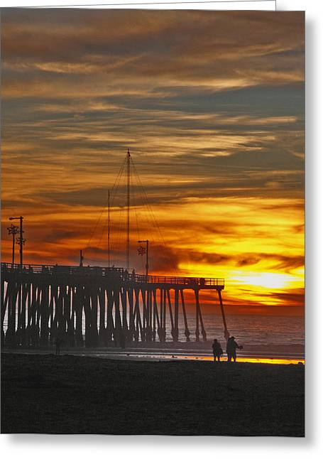 Couple On Beach Greeting Cards - A Firey Sunset- Pismo Beach Greeting Card by Gary Brandes