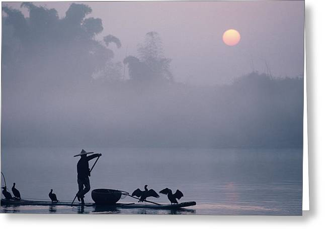 Five Level Greeting Cards - A Fisher Uses Cormorants To Capture Greeting Card by Kenneth Ginn