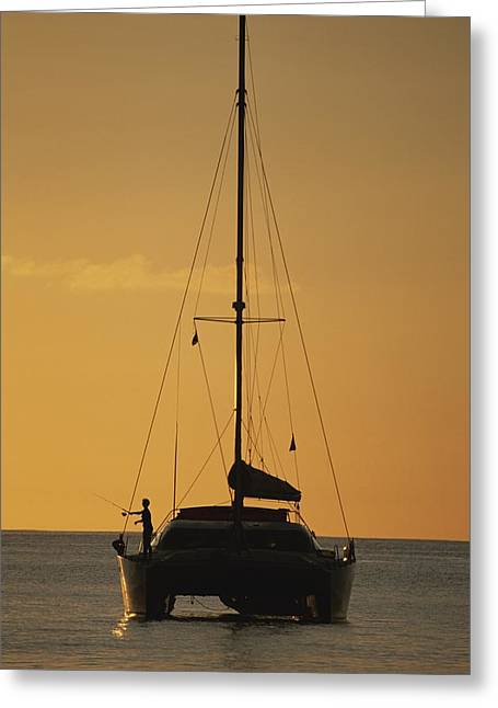 Light And Dark Greeting Cards - A Fisherman And His Sailboat Greeting Card by Michael Melford