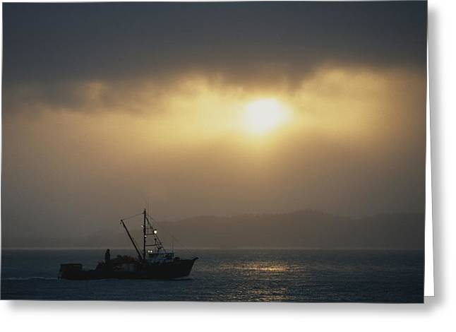 Sunset Scenes. Greeting Cards - A Fishing Boat Heads Out To Sea Greeting Card by Norbert Rosing