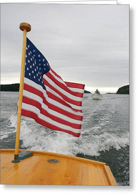 Overcast Day Greeting Cards - A Flag Waves On The Stern Of A Maine Greeting Card by Heather Perry