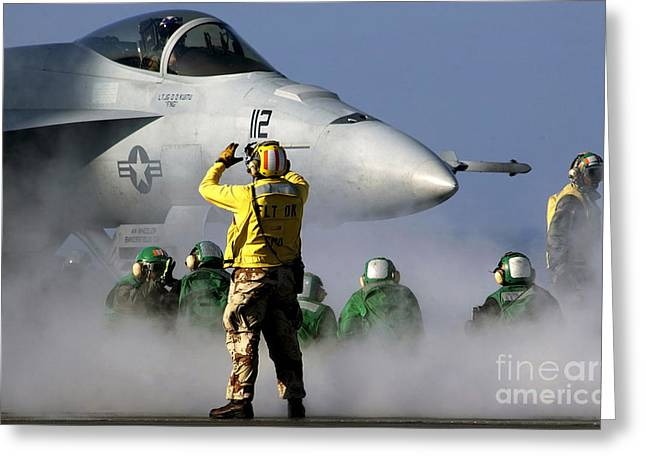 F-18 Greeting Cards - A Flight Deck Handler Directs An Fa-18e Greeting Card by Stocktrek Images