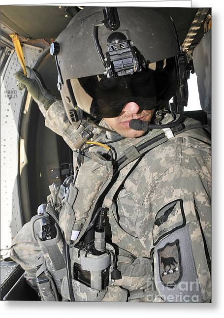 Iraq Greeting Cards - A Flight Medic Conducts A Daily Greeting Card by Stocktrek Images