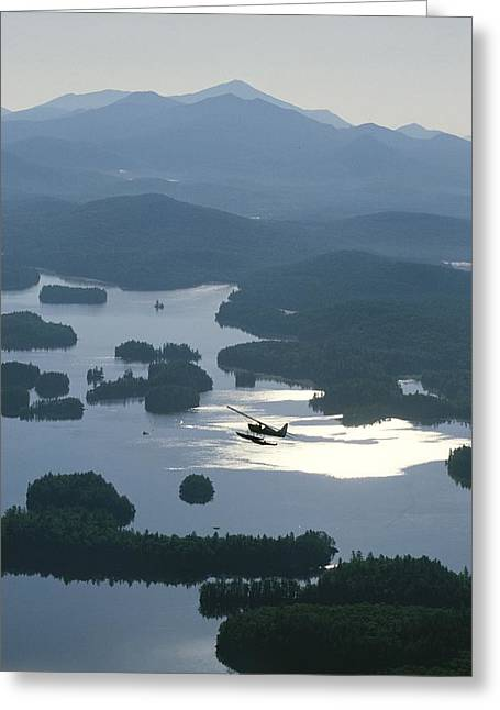 Middle Atlantic States Greeting Cards - A Floatplane Flies Over Long Lake Greeting Card by James P. Blair