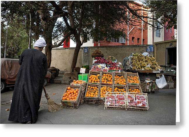 Traveling Salesman Greeting Cards - A Fruit Seller Sweeps In Front Greeting Card by Taylor S. Kennedy