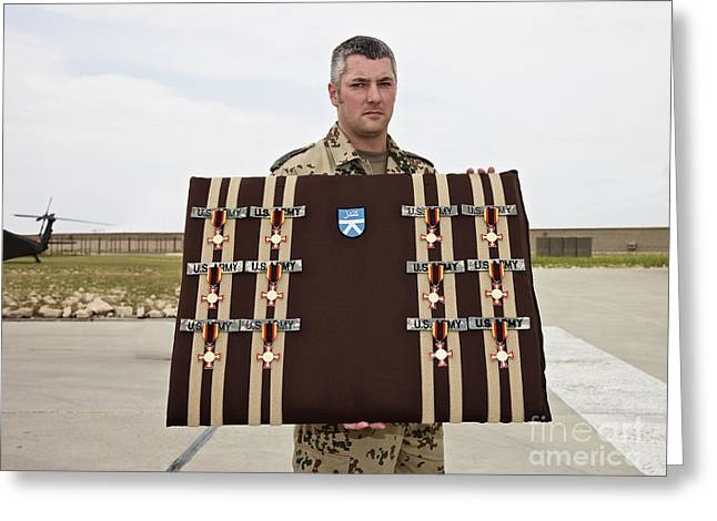 A German Soldier Holds A Display Greeting Card by Terry Moore