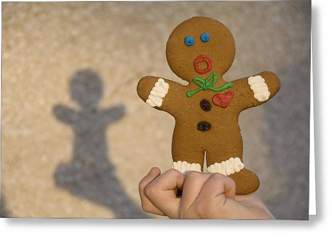 Model Release Greeting Cards - A Gingerbread Cookie Looks Scared While Greeting Card by Joel Sartore