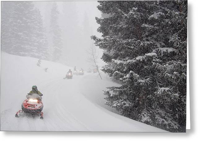 Snowmobile Greeting Cards - A Group Of Snowmobilers Turn A Corner Greeting Card by Taylor S. Kennedy