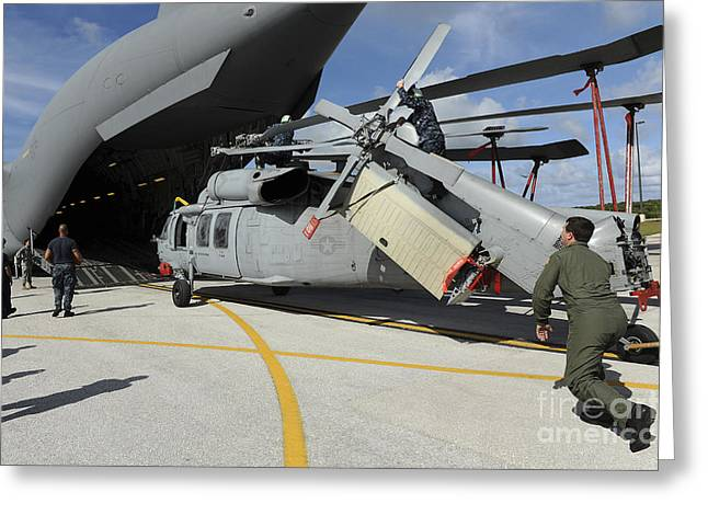 Rotorcraft Photographs Greeting Cards - A Helicopter Is Loaded Onto A C-17 Greeting Card by Stocktrek Images