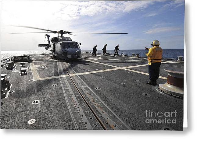 A Helicpter Sits On The Flight Deck Greeting Card by Stocktrek Images