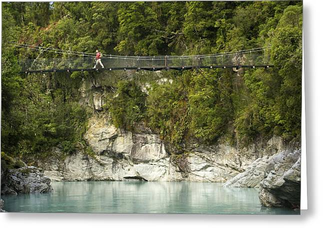 Knapsack Greeting Cards - A Hiker On A Swing Bridge Greeting Card by Bill Hatcher