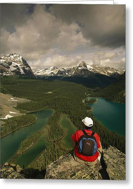 Knapsack Greeting Cards - A Hiker Takes In The Panoramic View Greeting Card by Michael Melford