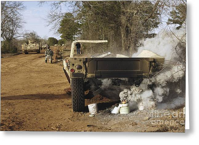 Hmmwv Greeting Cards - A Humvee Burns After A Simulated Greeting Card by Stocktrek Images