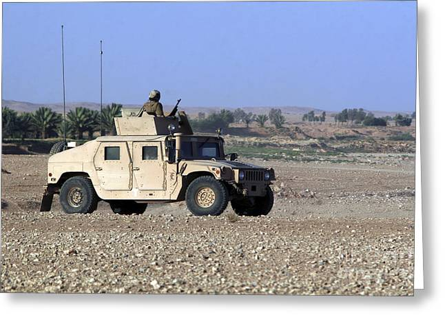 Hmmwv Greeting Cards - A Humvee Filled With Marines Conducting Greeting Card by Stocktrek Images