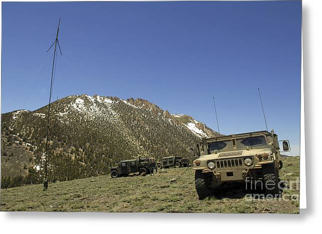 Center Field Greeting Cards - A Humvee Is Parked Greeting Card by Stocktrek Images