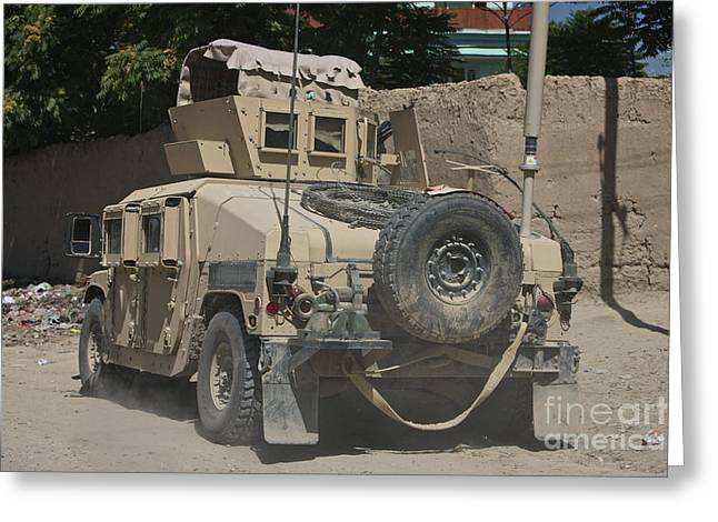 Hmmwv Greeting Cards - A Humvee Patrols The Streets Of Kunduz Greeting Card by Terry Moore