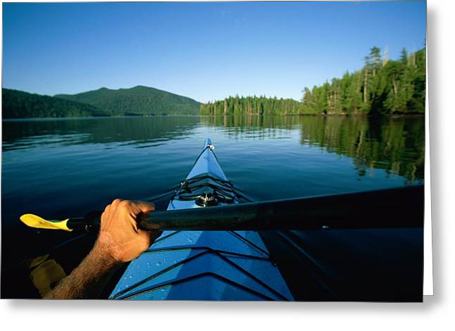 Kayak Greeting Cards - A kayaker sails across Greeting Card by Barry Tessman