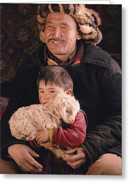 Informal Portraits Greeting Cards - A Kazakh Eagle Hunter And His Son Greeting Card by David Edwards